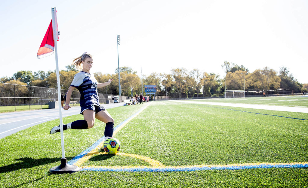 Girls' soccer star Sydney Urban kicking a corner