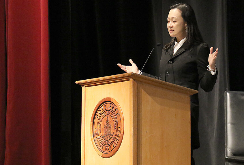 poly prep context min jin lee speaking at podium