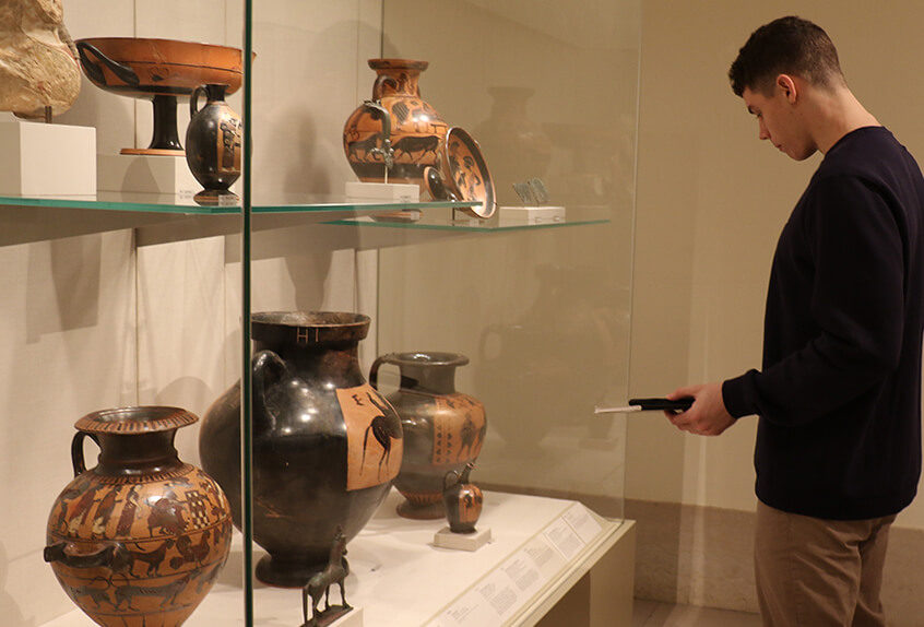 US AP History at MET for Art of Native American exhibit student looks at pottery