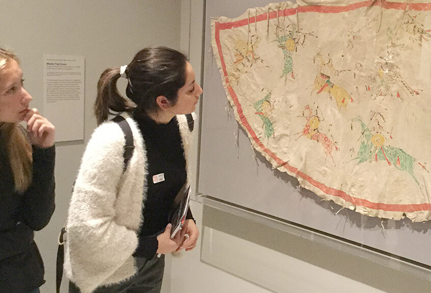 US AP History at MET for Art of Native American exhibit students take a close look at fabric