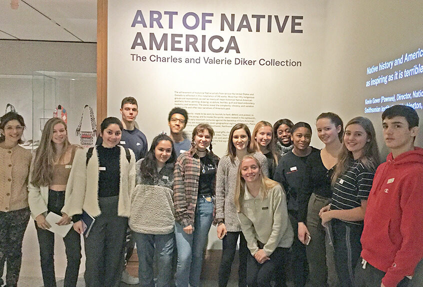 US AP History at MET for Art of Native American exhibit students and faculty in front of sign