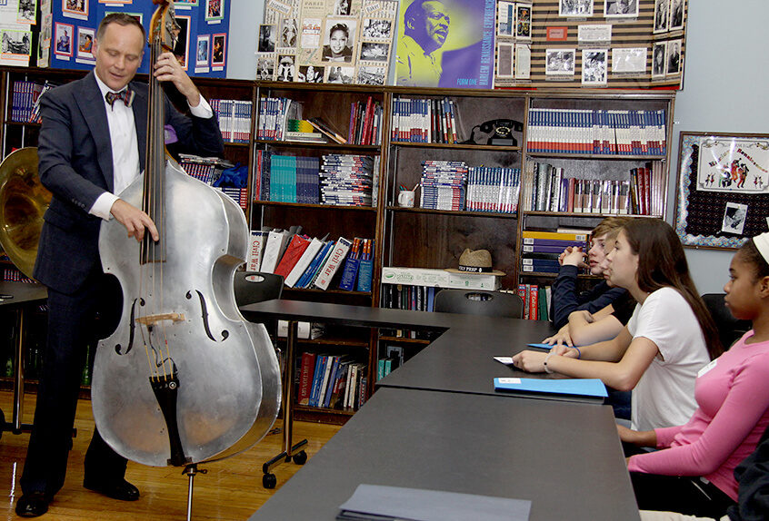 Middle School Harlem Renaissance project guest musician playing standup bass