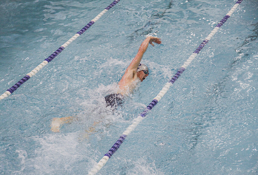 Boy swimmer racing