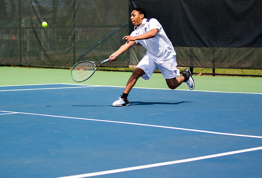Boys Tennis player hitting the tennis ball
