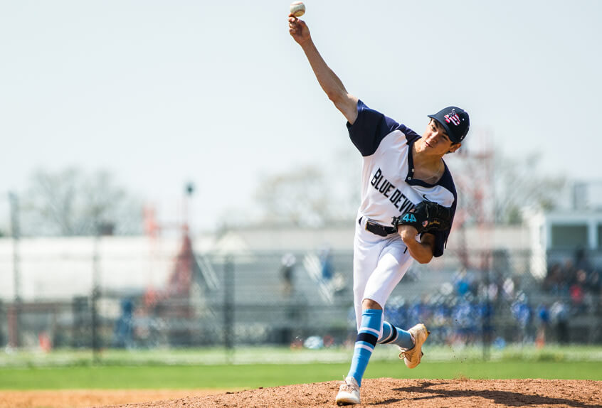 Poly Prep Baseball pitcher throwing the ball