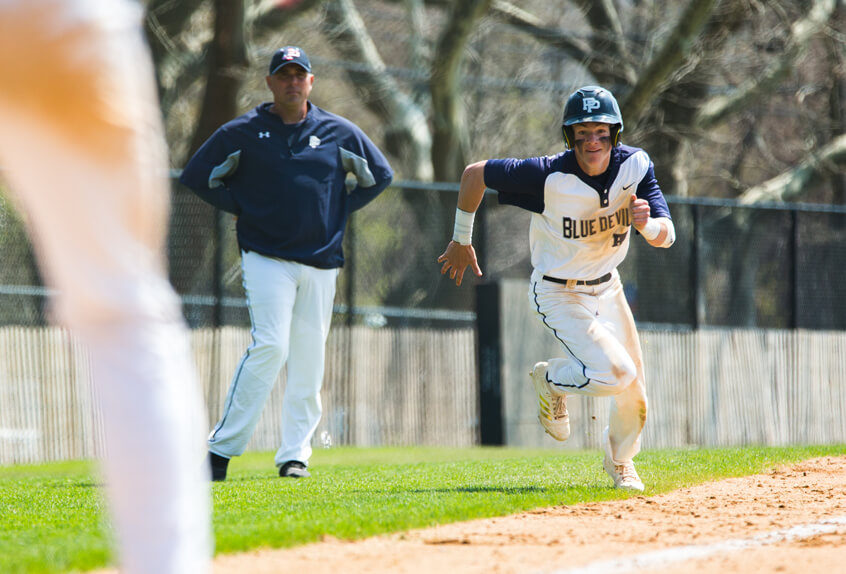 Poly Prep baseball athlete running for the base