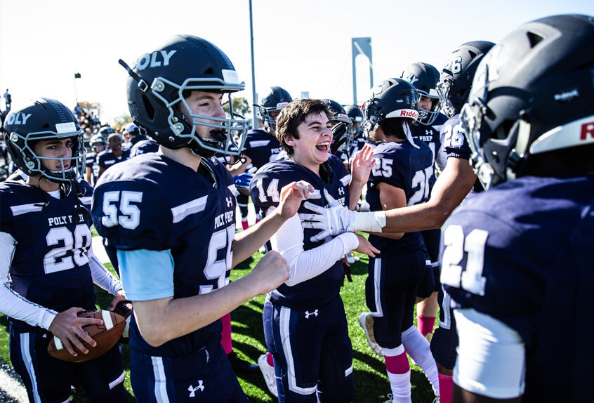 Poly Prep Football team cheering after a win