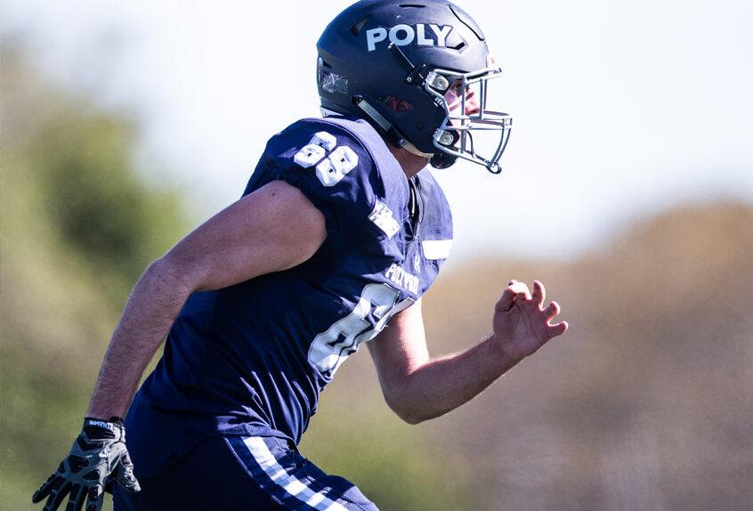 Poly Prep Varsity Team football player running
