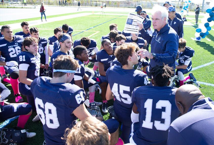 Coach Fountaine talking with the Poly Prep Varsity Football team