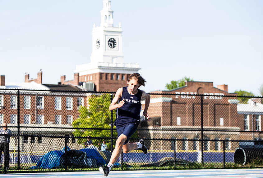 Track and field boy running