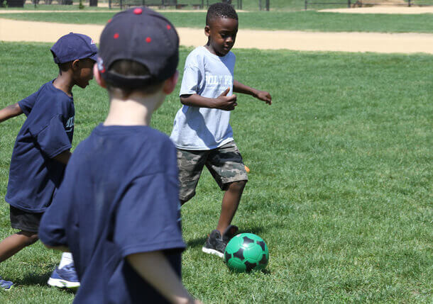 Poly Prep Lower School students playing soccer