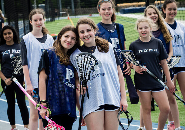 Poly Prep Middle Schoolers learning to play lacrosse
