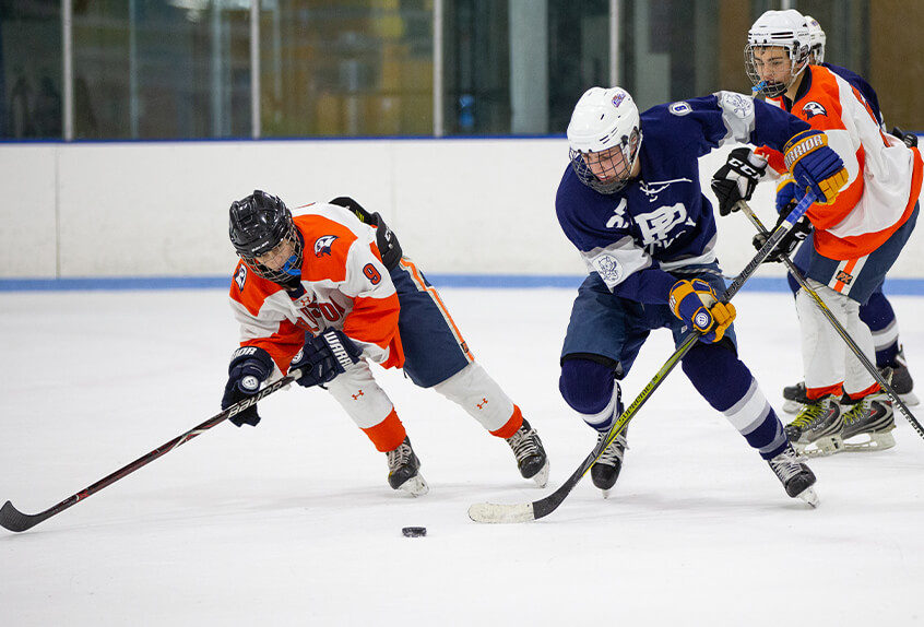 Poly Prep students playing hockey