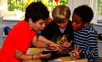Admissions Lower School students looking at screen