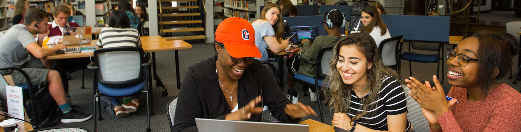 Admissions Upper School students working together in library