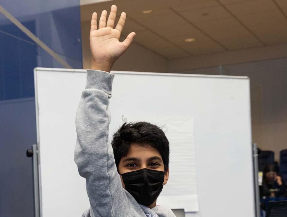 Masked Student raising hand